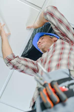 lighting technician: Man up a ladder Stock Photo