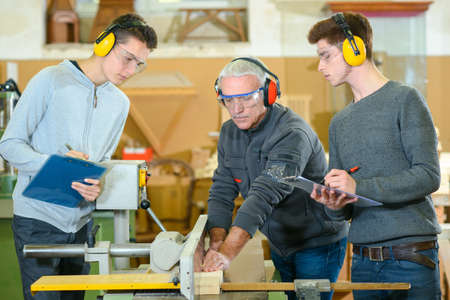 machine tool: Male students in a woodwork class
