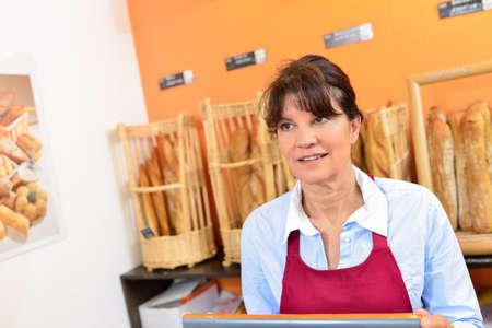 serf: Lady serving in bakery