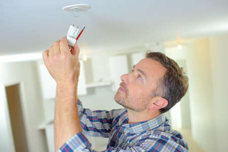 ceiling: Attaching a smoke alarm to the ceiling