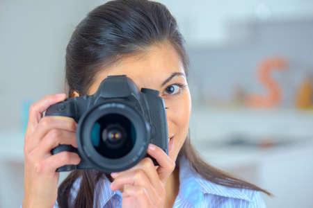 photographic camera: Female photographer