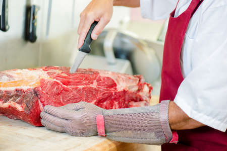 blades: Butcher cutting up beef