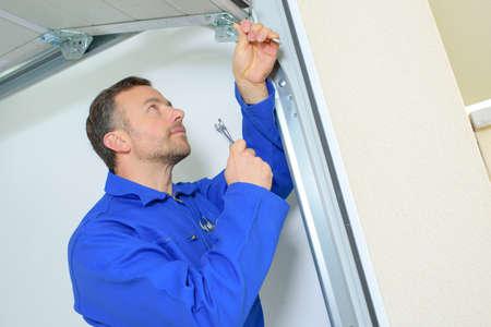 garage door: Repairing a garage door hinge