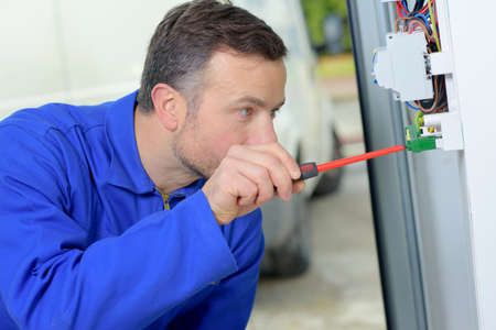 fusebox: Electrician working on a fusebox Stock Photo