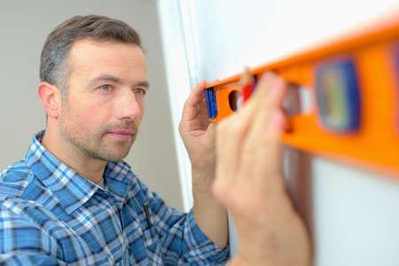 house inspection: Builder using a spirit level