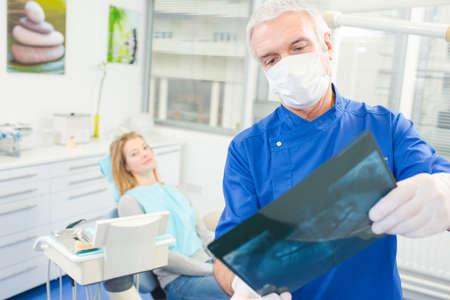 x ray image: Dentist examining an x ray image Stock Photo