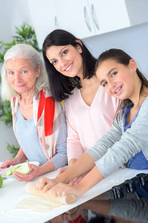 three generations of women: Three generations of women baking together