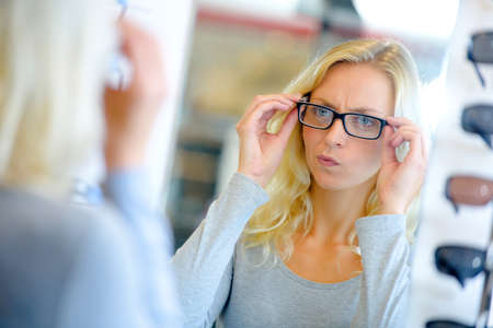 woman  glasses: Woman trying on some glasses