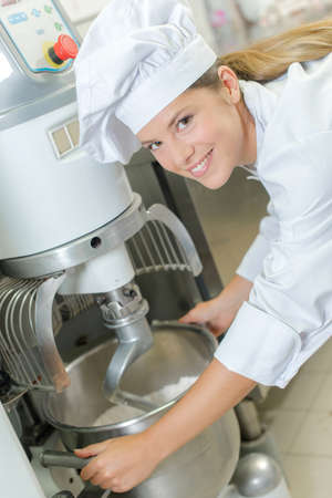 machinery: Chef using industrial mixer Stock Photo