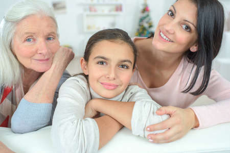 multi generational: Women of the family on a sofa
