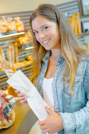 daily room: Purchasing her daily baguette Stock Photo