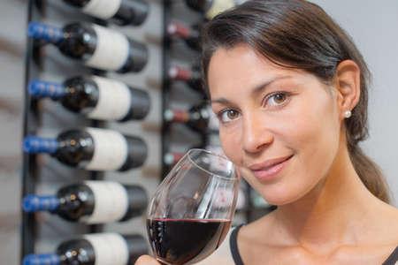 wineglasses: Woman tasting some wine