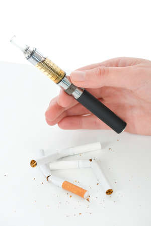 atomiser: Woman trying an electronic cigarette Stock Photo