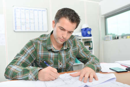 architect: Architect working on plans Stock Photo