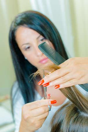 long nails: Hairdresser trimming ends