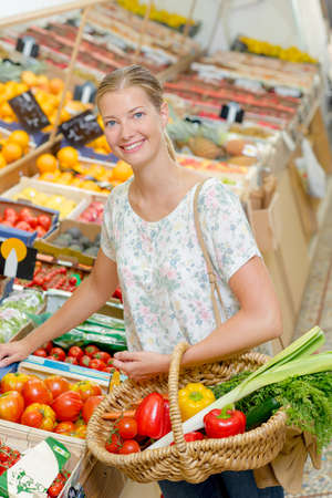 produce departments: Lady buying vegetables Stock Photo