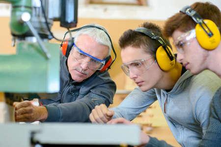Woodwork apprenticeship Фото со стока