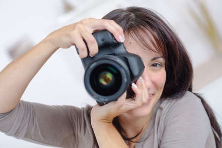 middle age women: Lady taking photograph