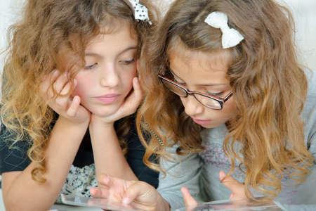 hairclip: Two girls looking at book