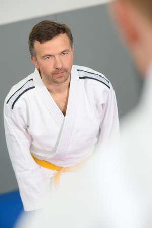 dojo: Bowing in a dojo Stock Photo