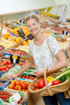 produce departments: Lady choosing fruit and veg