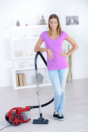 stood: Woman stood with a vacuum cleaner