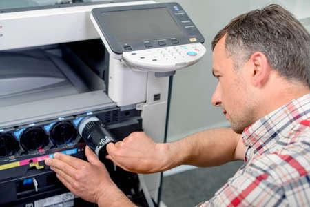 printer ink: Changing printer ink Stock Photo