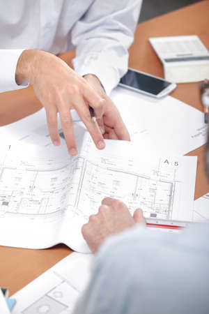 joint effort: Let double check these plans Stock Photo