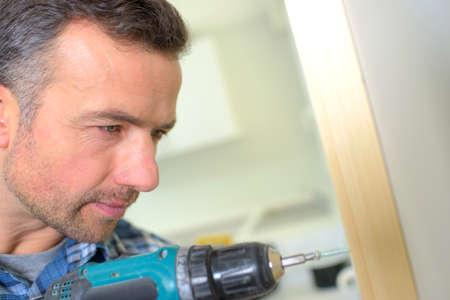 Carpenter drilling Reklamní fotografie