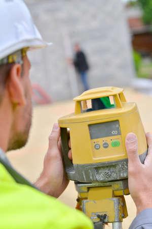 exact position: Site surveyor taking measurements Stock Photo