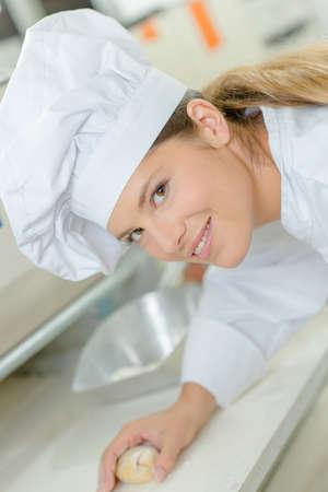 nourish: Woman kneading some dough