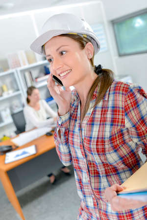 female architect: Female architect on speaking to client on the phone