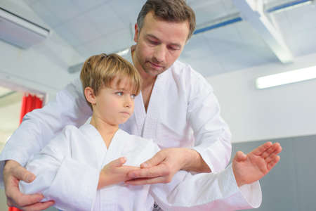 martial art: Little boy in a karate lesson
