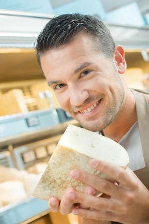 chunk: Man holding chunk of cheese