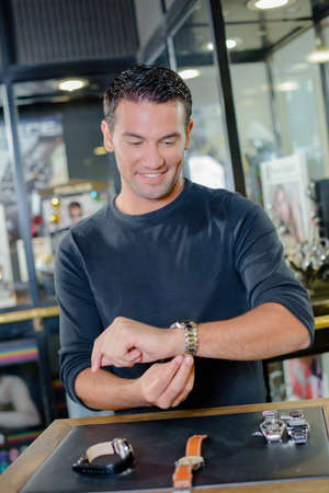 human wrist: Man shopping for a watch
