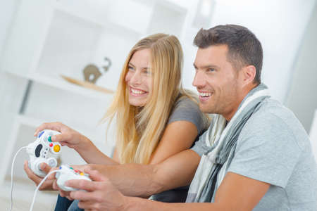 accomplices: Couple playing video games Stock Photo