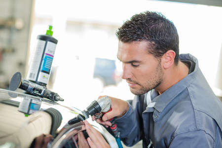 polisher: Mechanic cleaning a customers car Stock Photo