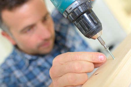 Man using an electric screwdriver