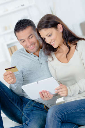 purchase: Couple making an on-line purchase
