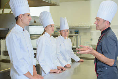 addressing: Chef addressing trainee cooks