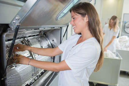 industrial: woman and washing machine Stock Photo