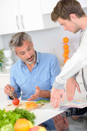 younger man: Man preparing meal, hand gestures with younger man