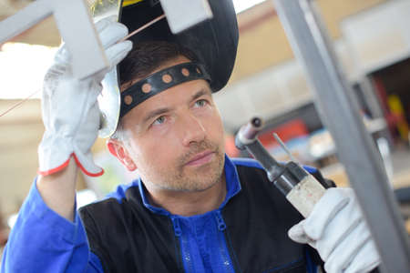 blowtorch: welder with a blowtorch Stock Photo