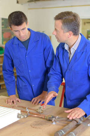 explaining: Plumber explaining to student