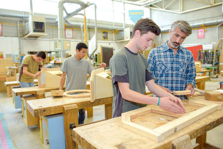 woodwork: Students in a woodwork class Stock Photo