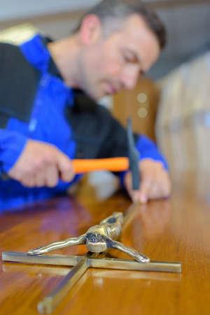 forger: man hammering