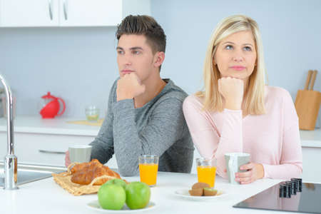 trouble: Couple in a bad mood in the kitchen