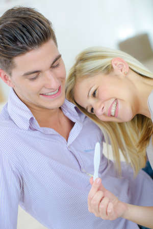 pregnancy test: Couple holding pregnancy test Stock Photo