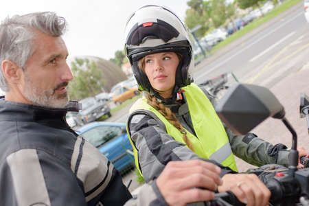 test drive: Woman having driving lesson on a motorcycle