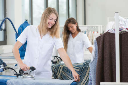 Two professional ladies ironing